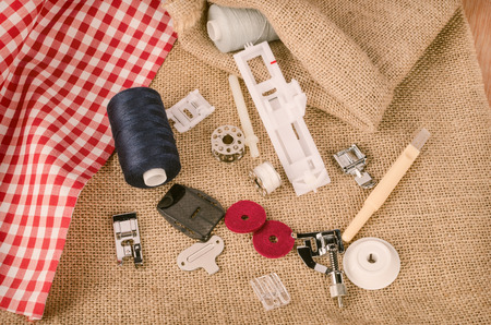 machine parts: Sewing machine parts in a still life with yarn spools