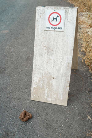 nuisance: Dog excrement near a no fouling sign