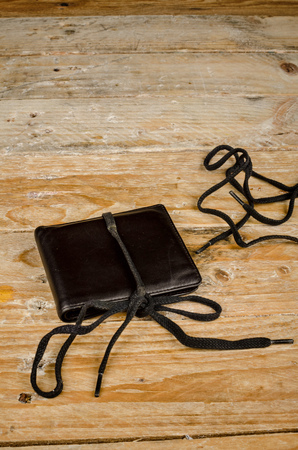 budget restrictions: Wallet on a shoestring, a financial concept
