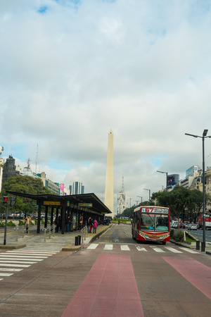 julio: BUENOS AIRES, ARGENTINA - AUGUST 10: People walking around the obelisk on 9  de Julio Avenue Editorial
