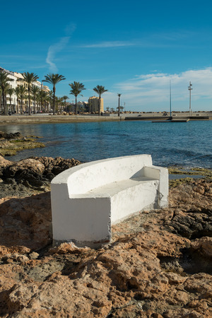 blanca: Stone benches on scenic Torrevieja  beach, Costa Blanca, Spain