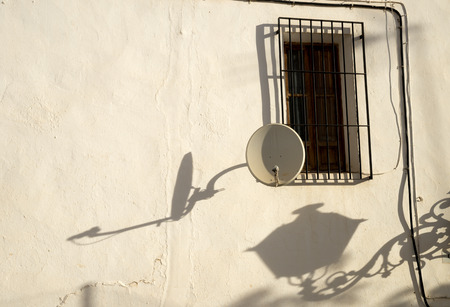 whitewashed: Old whitewashed Mediterranean facade with several shadows Stock Photo