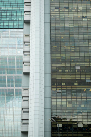 high rise buildings: Full frame take of two mirrored corporate high rise buildings