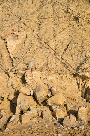 geological feature: Heavy metal netting on a cliff to avoid falling rocks and landslides Stock Photo