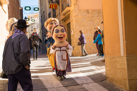 traditonal: COSTA BLANCA, SPAIN - JANUARY 16:  Parade of cabezudos, disguises with oversized heads, during a traditonal festival Editorial