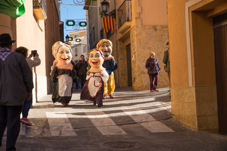 disguises: COSTA BLANCA, SPAIN - JANUARY 16:  Parade of cabezudos, disguises with oversized heads, during a traditonal festival Editorial