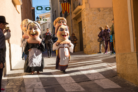 oversized: COSTA BLANCA, SPAIN - JANUARY 16:  Parade of cabezudos, disguises with oversized heads, during a traditonal festival Editorial