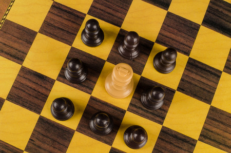 upheaval: Pawns surrounding king, a social upheaval concept Stock Photo