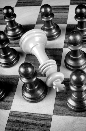 pawns: Pawns surrounding king, a social upheaval concept Stock Photo
