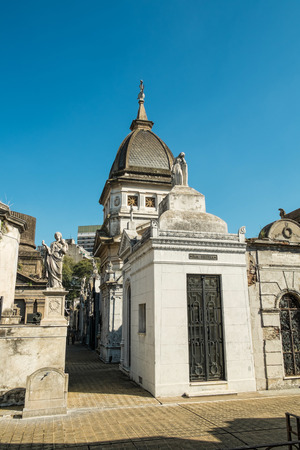 crypt: BUENOS AIRES, ARGENTINA - AUGUST 15 2015:  Recoleta Cemetry in downtown Buenos Aires,  a popular landmark with tourists and burial place of Eva Peron Editorial