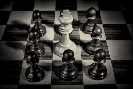 Pawns surrounding king, a social upheaval concept Stock fotó