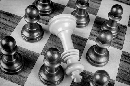 Pawns surrounding king, a social upheaval concept Stock Photo
