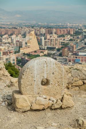 millstone: Old millstone on display in Alicante Santa Barbara castle