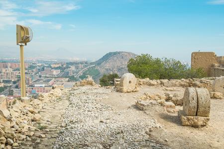 millstone: Old millstones on display in Alicante Santa Barbara castle