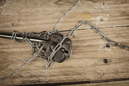 repression: Pen, barbed wire and padlock, a freedom of press concept