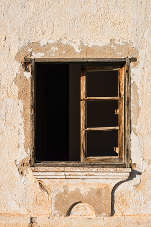 disrepair: Old window with  no glass