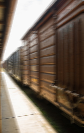 freight train: Freight train carriages speeding by. motion blur Stock Photo