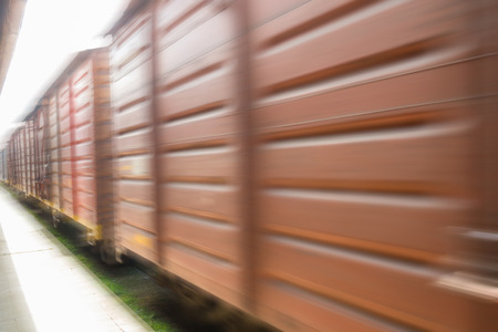 motion blur: Freight train carriages speeding by. motion blur Stock Photo