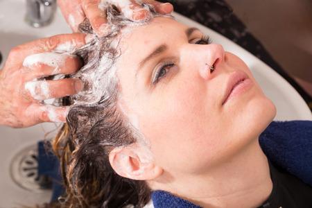 hair stylist: Hair stylist shampooing hair of a female customer