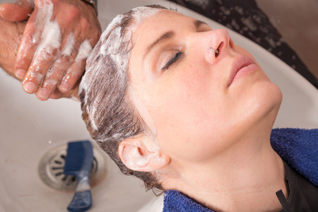 shampooing: Hair stylist shampooing hair of a female customer