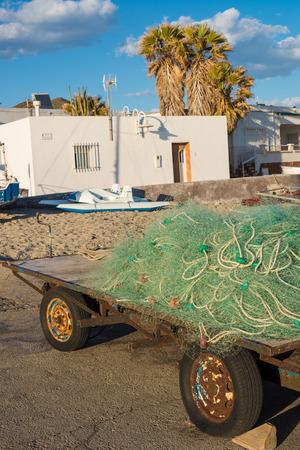 redes de pesca: Traditional fishing nets in a small Mediterranean harbor Foto de archivo