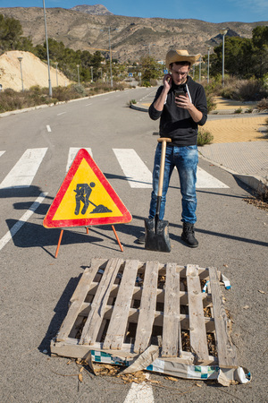 slack: Lazy guy on a  road works site, a concept