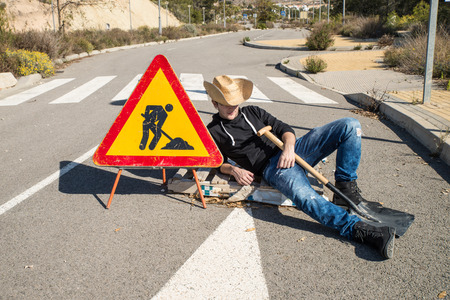 road works: Lazy guy on a  road works site, a concept