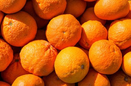 market stall: Full frame take of fresh tangerines on a street market stall