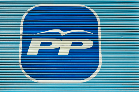 rajoy: MADRID, SPAIN - APRIL 17,  2016:  Logo of the ruling Spanish Partido Popular painted on a shutter door amidst political uncertainty and looming new elections. Editorial