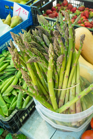 street market: Green asparagus among other produce on a street market stall Stock Photo