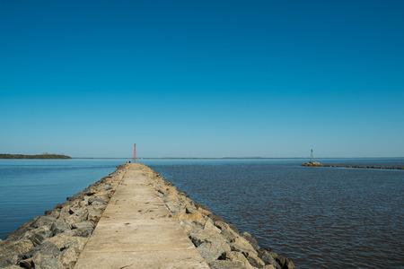 Large breakwater and beacon on Carmelo harbor, Uruguay