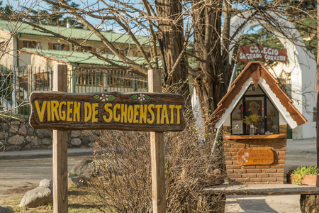 german culture: VILLA GENERAL BELGRANO, ARGENTINA - AUGUST 25 2015: Sign and small chapel reminding the German origin of its settlers Editorial
