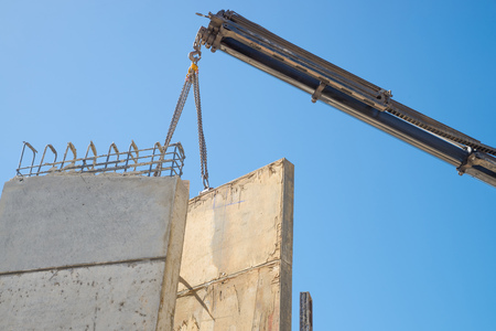 finished: Cane removing encasement for a finished concrete wall Stock Photo