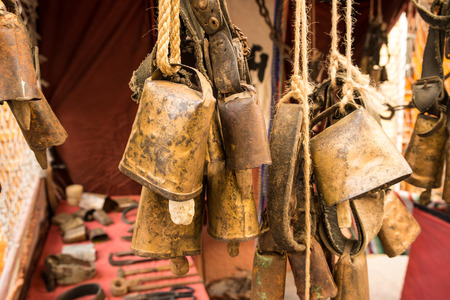 tarnished: Old cowbells and other related objects on a medieval market stall