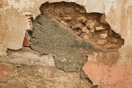 crumbling: Detail take of a crumbling wall