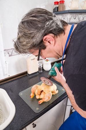 spoilt: Guy trying to chop a chicken with a  grinder disk on his DIY drill