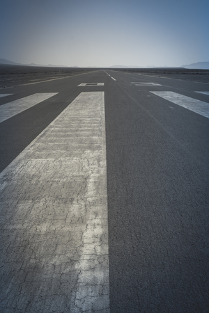 markings: Long paved runway shot from its threshold markings