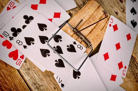 ploy: Cards inside a mousetrap, a gambling addiction concept Stock Photo