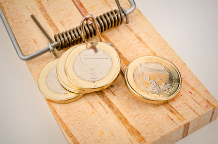 mouse trap: Euro coins on a mouse trap, a concept representing the currrent troubles of the European currency Stock Photo