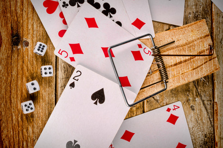 compulsive: Cards and dice in a conceptual shot depictiing compulsive gambling Stock Photo