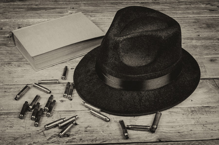 organized crime: A conceptual still life standing for  the crime and mystery novel genre