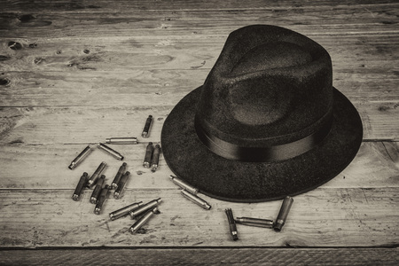 organized crime: Fedora hat and bullets, a film noir concept