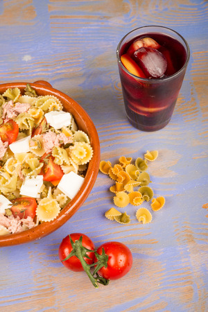summery: Pasta salad served with a glass of sangria, a very summery combination
