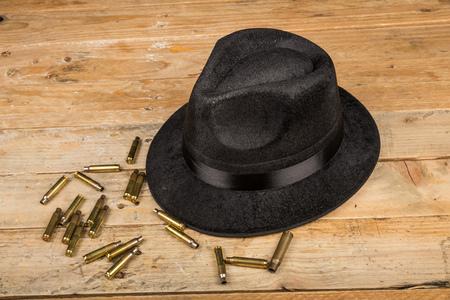 film noir: Fedora hat and bullets, a film noir concept