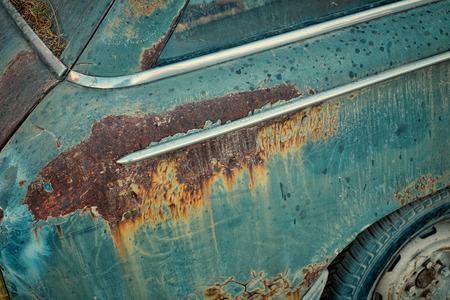 abandoned car: Rusty bodywork on an abandoned car