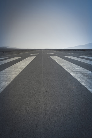 paved: Long paved runway shot from its threshold markings