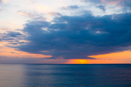 Stormy skies over calm Mediterranean waters