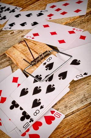 mousetrap: Cards inside a mousetrap, a gambling addiction concept Stock Photo
