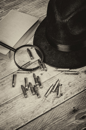 film noir: Conceptual still life standing for film noir and crime and mystery novel genre Stock Photo