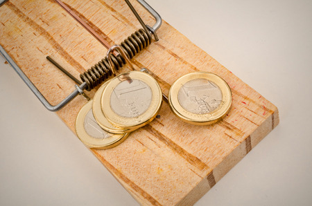 Euro coins on a mouse trap, a concept representing the currrent troubles of the European currency Stock Photo